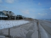Manmade dune vegetation between homes and sea